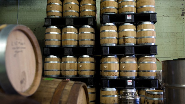 Five-gallon barrels filled with a variety of rums and whiskeys lined the wall at Eleven Wells Tuesday, June 16, 2015 in St. Paul. Courtesy of Jennifer Simonson | MPR News