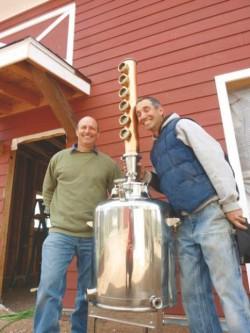 Jeff Leonardo and Claude Seeman with 808 Distillery still (Photo courtesy of Derek Franz/dfranz@eaglevalleyenterprise.com)